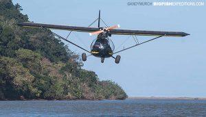 Spotter plane buzzing a boat.
