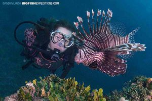 Diver with a lionfish